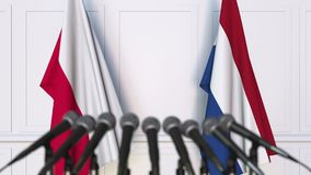 Flags of Poland and Netherlands at international meeting or negotiations press conference. 3D animation stock footage