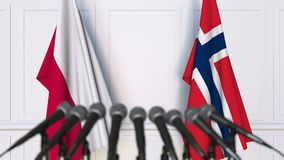 Flags of Poland and Norway at international meeting or negotiations press conference. 3D animation stock video