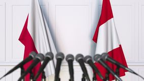 Flags of Poland and Peru at international meeting or negotiations press conference. 3D animation stock footage