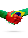 Flags Portugal, Brazil countries, partnership friendship handshake concept. Royalty Free Stock Photography