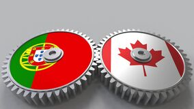 Flags of Portugal and Canada on meshing gears. International cooperation conceptual animation. Flags of Portugal and Canada on meshing gears. International stock video footage