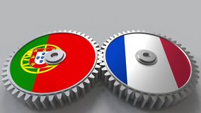 Flags of Portugal and France on meshing gears. International cooperation conceptual animation. Flags of Portugal and France on meshing gears. International stock footage