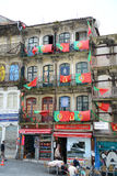 Flags of Portugal outside a balcony in Porto, Portugal Stock Photos