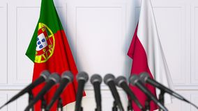 Flags of Portugal and Poland at international meeting or negotiations press conference. 3D animation stock video footage