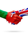 Flags Portugal, United Kingdom countries, partnership friendship handshake concept. Stock Image