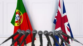 Flags of Portugal and The United Kingdom at international meeting or negotiations press conference. 3D animation stock video footage