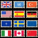 Flags on the post stamps Stock Photography