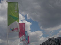 Flags Promoting the 2012 London Olympics. A series of green, pink, and blue flags against a cloudy blue sky and reading Enjoy It, Share It, and Discover It Stock Photos