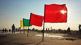 Flags on a beach Royalty Free Stock Photography