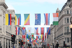 Flags Regent Street. LONDON, UK - June 22: Regent Street with a stunning display of flags representing every competing nation in the forthcoming sports event in Royalty Free Stock Photo