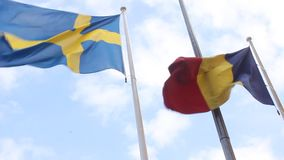 Flags of Romania and Sweden stock footage