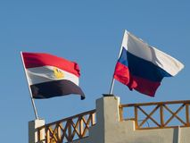 Flags. On the roof. Russia and Egypt on sky background Stock Image