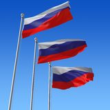 Flags of Russia against blue sky. Stock Photos