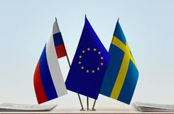 Flags of Russia European Union and Sweden. Desktop flags of Russia European Union and Sweden royalty free stock photos