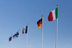 Flags of Russia, Finland, Germany and Italy against the sky Stock Image