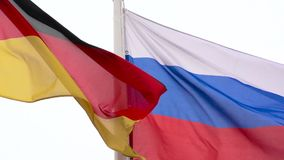 The flags of Russia and Germany. The flags of Russia and Germany means international diplomacy stock footage