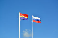 Flags of Russia and the Kaliningrad region, fluttering against the blue sky Stock Image