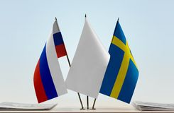 Flags of Russia and Sweden. Desktop flags of Russia and Sweden with a white flag in the middle royalty free stock photo