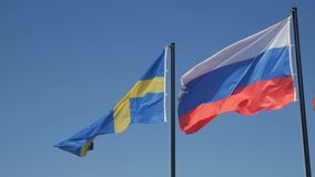 Flags of Russia and Sweden stock video footage