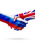 Flags Russia, United Kingdom countries, partnership friendship handshake concept. Stock Images