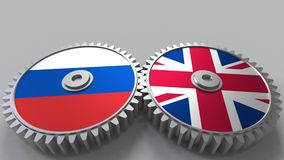 Flags of Russia and The United Kingdom on meshing gears. International cooperation conceptual animation. Flags of Russia and The United Kingdom on meshing gears stock video
