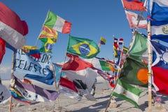 Flags in a salt desert of Salar de Uyuni in Bolivia royalty free stock photos