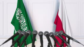 Flags of Saudi Arabia and Poland at international meeting or negotiations press conference. 3D animation stock footage