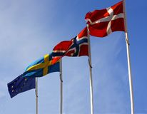 Flags from the Scandinavian countries Denmark, Norway and Sweden waving from flagpoles together with the EU, European Union, flag. Against a blue sky - stock royalty free stock photos
