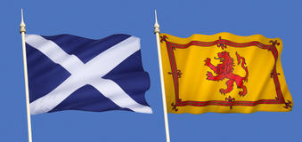 Flags of Scotland. Scottish Flags - The national flag (the Saltire) and the Lion Rampant (Royal Standard of Scotland stock photography