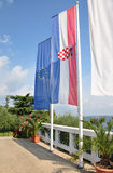 Flags at sea. Flags of Croatia and the EU against the background of the sea stock photo