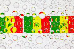 Water drops on glass and flags of Senegal royalty free stock image