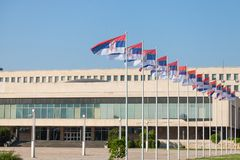 Flags of Serbia waiving in front of SIV, or Palata Srbija, or Palace of Serbia. It is the headquarters of the Serbian government. Picture of SIV building, also stock photo