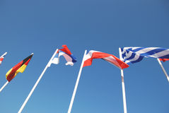 Flags set of masts on a background of blue sky.  Royalty Free Stock Images