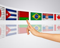 Flags of several countries. Virtual screens. Flags of several countries. Finger presses one of virtual screens. Mirror reflection Stock Photography