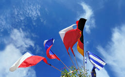 Flags of several Europe states against cloudy sky Stock Photo