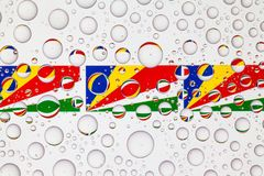 Water drops on glass and flags of Seychelles stock illustration