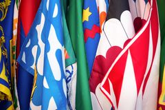 Flags of the Siena contrade districts, Palio festival background, in Siena, Tuscany Italy. Flags of the Siena contrade districts, Palio festival background, in Royalty Free Stock Photo