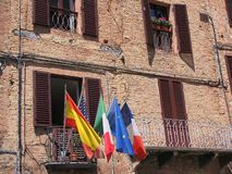 Flags on Sienna Balcony, Italy Royalty Free Stock Photos