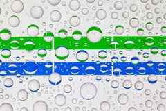 Water drops on glass and flags of Sierra Leone vector illustration