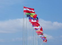Flags of some countries on background blue sky Royalty Free Stock Photos