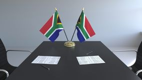 Flags of South Africa and papers on the table. Negotiations and signing an agreement. Conceptual 3D rendering. Flags and papers on the table. Negotiations and vector illustration