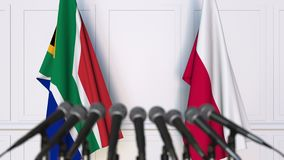 Flags of South Africa and Poland at international meeting or negotiations press conference. 3D animation stock video footage