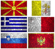 Flags of South Europe 2. Macedonia, Vatican, Slovenia, Malta, Greece, and Monte-negro flags of wall texture Stock Photos