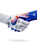Flags South Korea, Australia countries, partnership friendship handshake concept. Flags South Korea, Australia countries, handshake cooperation, partnership stock photos