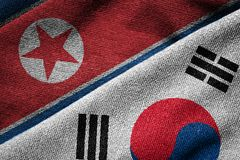 Flags of South Korea and North Korea on Grunge Texture Royalty Free Stock Photography
