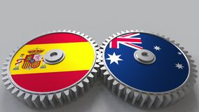 Flags of Spain and Australia on meshing gears. International cooperation conceptual animation. Flags of Spain and Australia on meshing gears. International stock footage