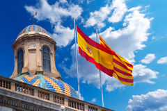 Flags of Spain and Catalonia Together. Detail of Palau de la generalitat de Catalunya in Barcelona, Spain with Spanish and Catalan flag waving in the wind Stock Images