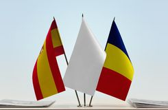Flags of Spain and Chad. Desktop flags of Spain and Chad with white flag between royalty free stock photos
