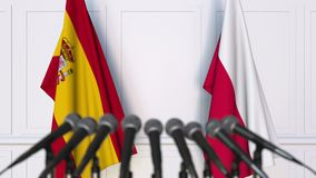 Flags of Spain and Poland at international meeting or negotiations press conference. 3D animation stock video