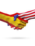 Flags Spain and United States countries, overprinted handshake. Royalty Free Stock Image